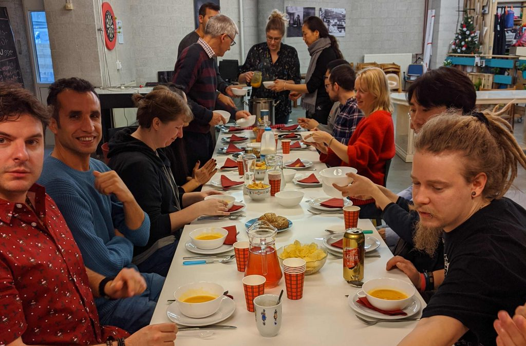 Ten members sitting at a long table having a dinner during our social dinner event.
